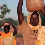 Two women fetch water in Yida refugee settlement. Unity State, July 2013. Credit OCHA.