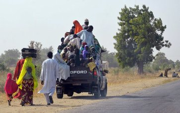 People flee from Boko Haram, in Mairi village on the outskirts of Maiduguri, Borno state. Photograph: Stringer/AFP/Getty Images