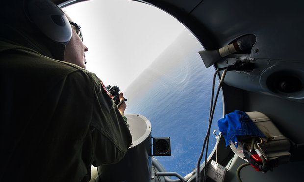 French soldier aboard an aircraft during searches for debris. Photograph: Alexandre Groyer/AFP/Getty Images