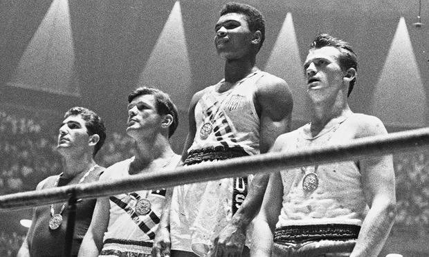 Cassius Clay wins gold at the Rome Olympics. Photograph: Central Press/Getty Images