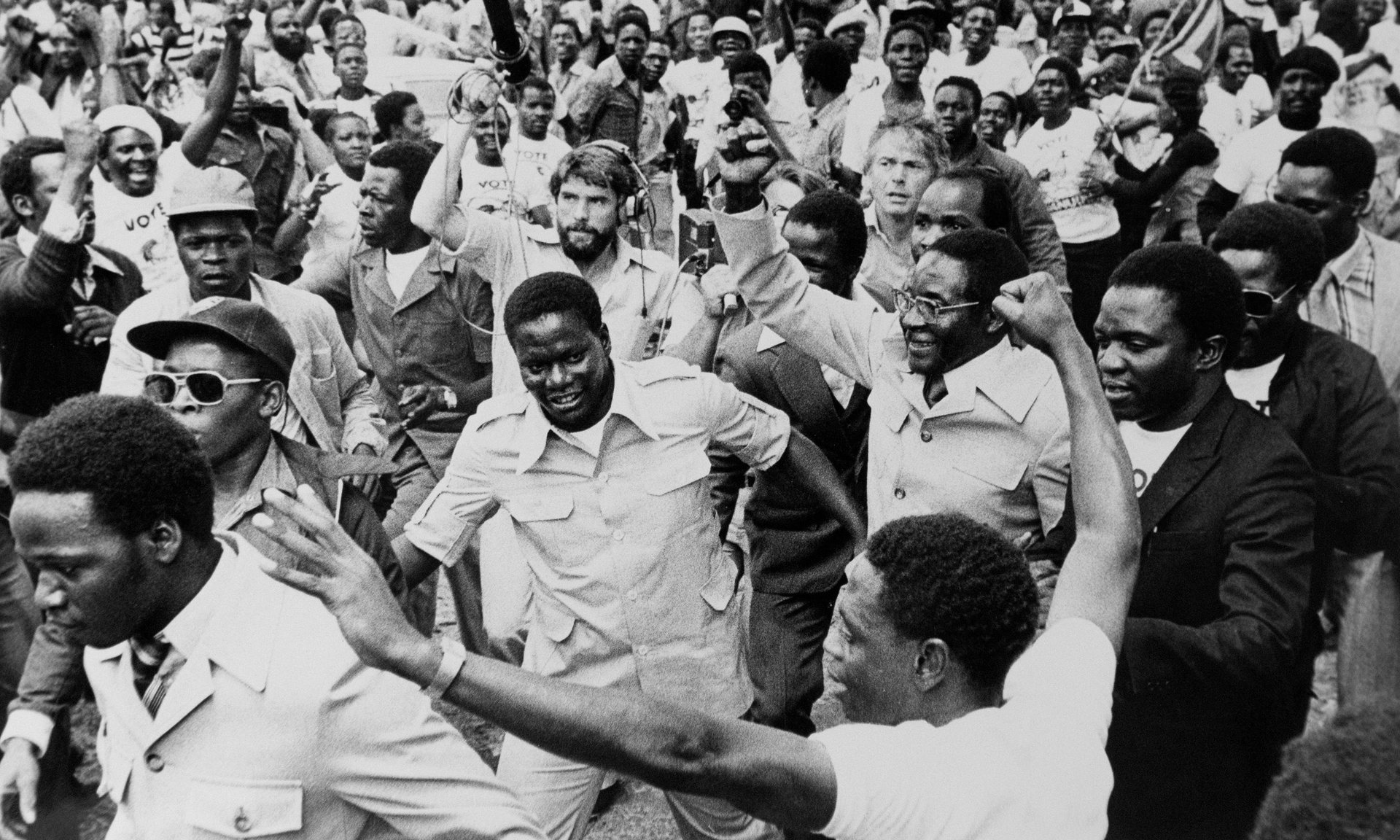 Robert Mugabe emerges from exile at Harare Fields, 1980. Photograph: Brian Harris / Rex Features