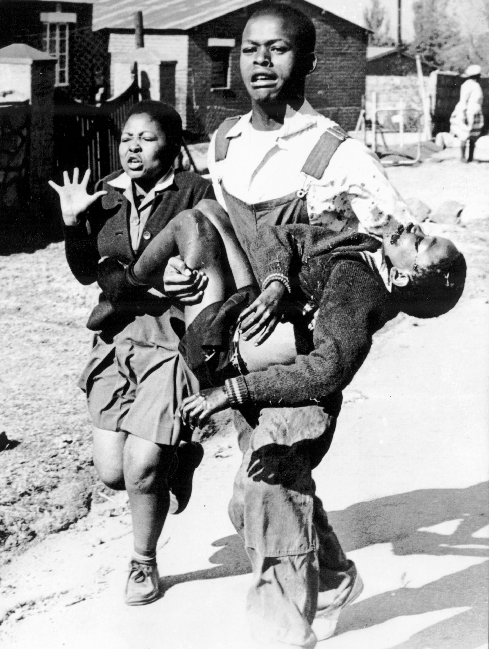 Umbiswa Makhubo carries the body of Hector Pieterson, photographed by Sam Nzima. Photograph: Sam Nzima/Archive