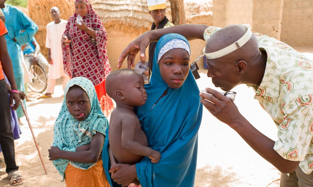 A girl has her eyes tested in Sokoto state, Nigeria. About 12 million children worldwide suffer from preventable or treatable blindness. Photograph: Graeme Robertson for the Guardian