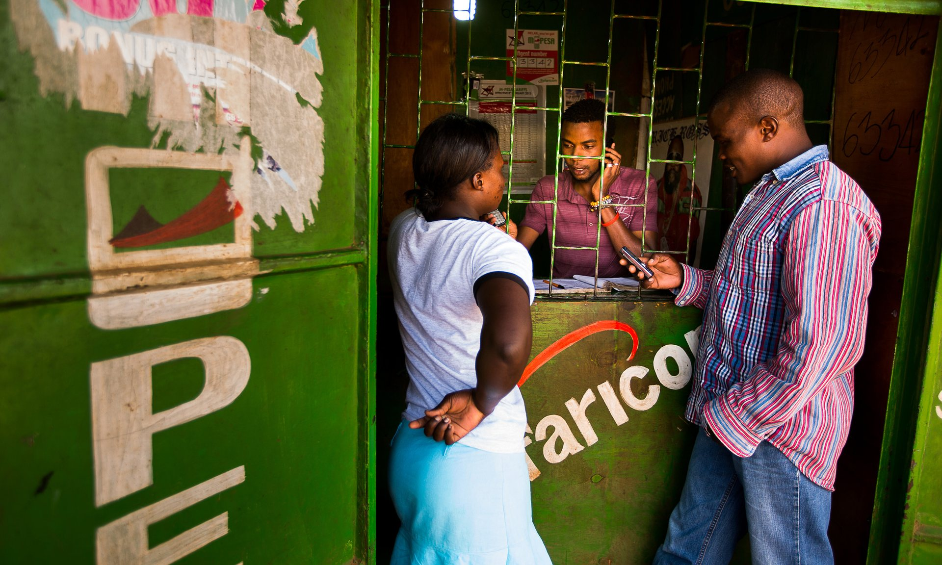 People transfer money using the M-Pesa mobile banking service at a store in Nairobi, Kenya, in 2013. Photograph: Bloomberg via Getty Images