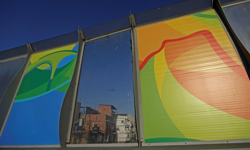 Banners (left and right) advertise the 2016 Rio Olympics. In the background is the Maré slum complex. Photograph: Ricardo Moraes/Reuters