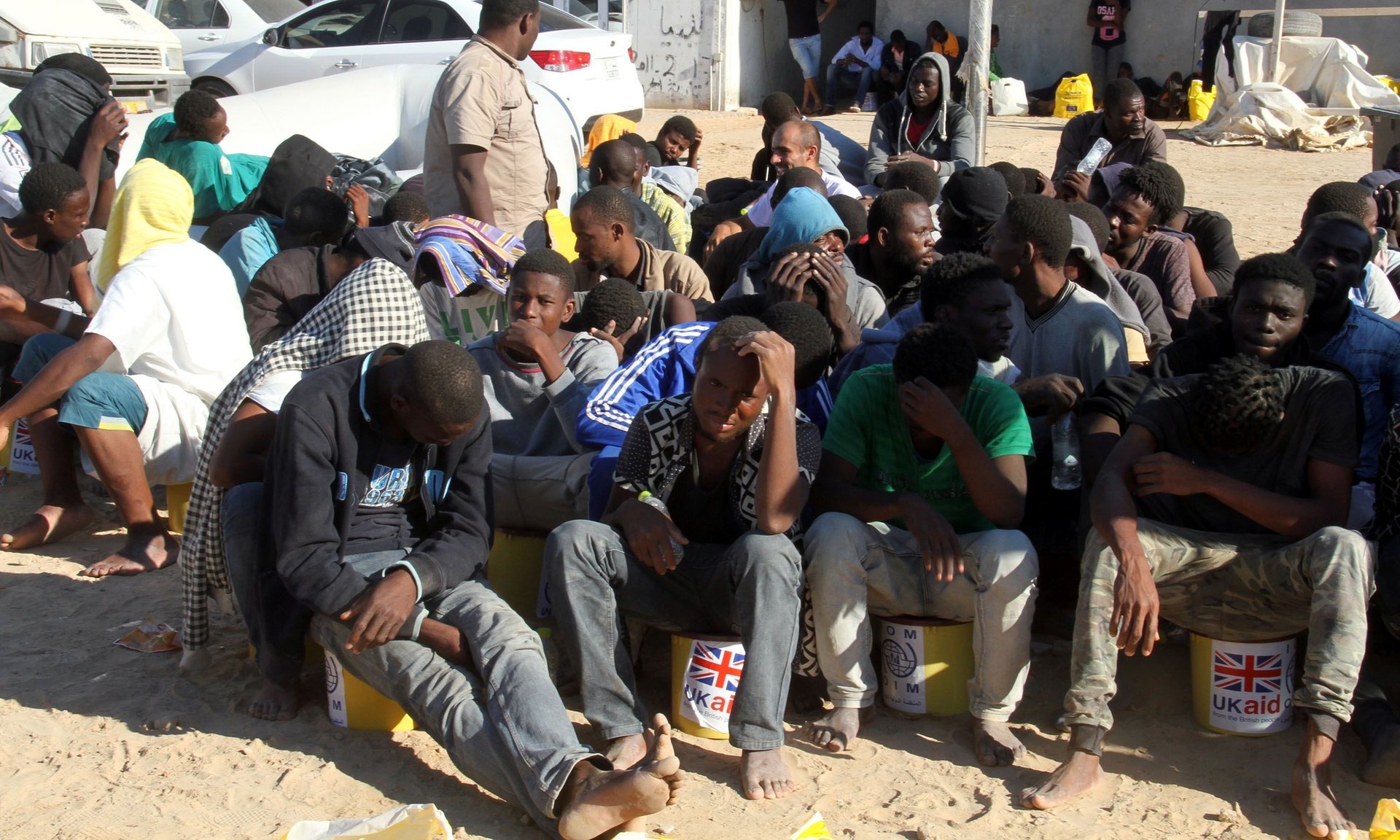 Illegal migrants in a port east of the Libyan capital, Tripoli. Hulme argues that 'any serious attempt to reduce the flow of Africans crossing the Mediterranean … entails rich nations actively promoting economic growth and job creation in Africa'. Photograph: AFP/Getty