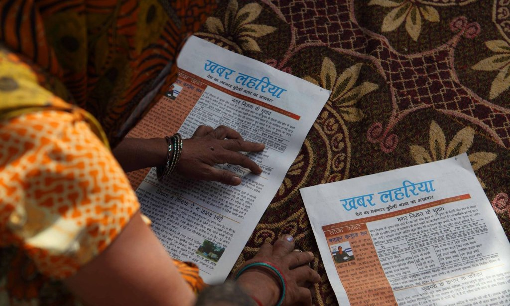 Staff pore over an edition of Khabar Lahariya (News Waves), which is edited entirely by women. All photographs courtesy of Khabar Lahariya
