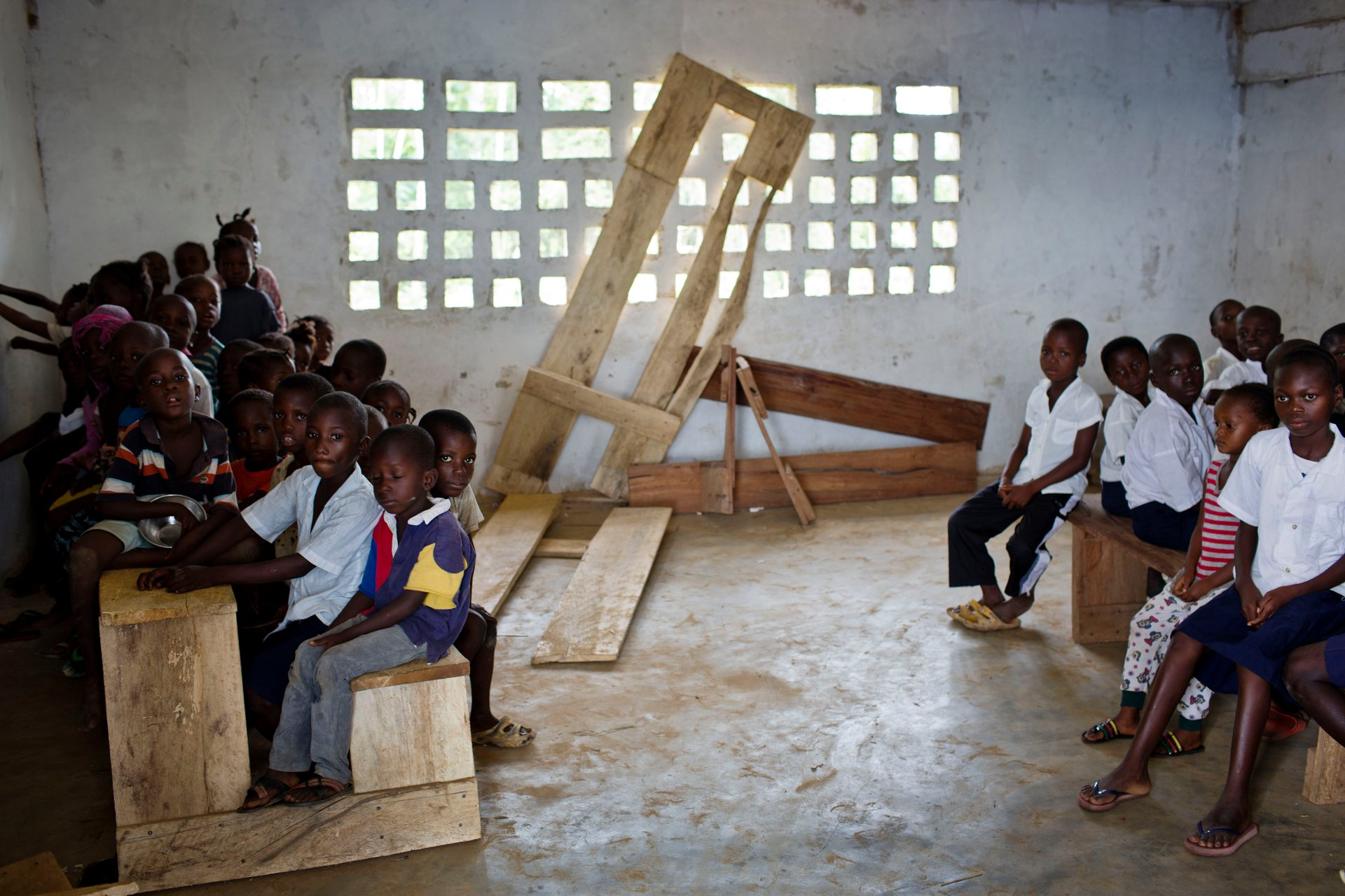 Liberia hopes that by bringing private companies into its education system it can end scenes like this at a Montserrado primary school where children are crammed on to classroom furniture. All photographs by Kate Holt