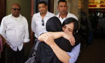 Celeste Nurse, right, the biological mother of the kidnapped child, embraces a family member. Photograph: Schalk van Zuydam/AP