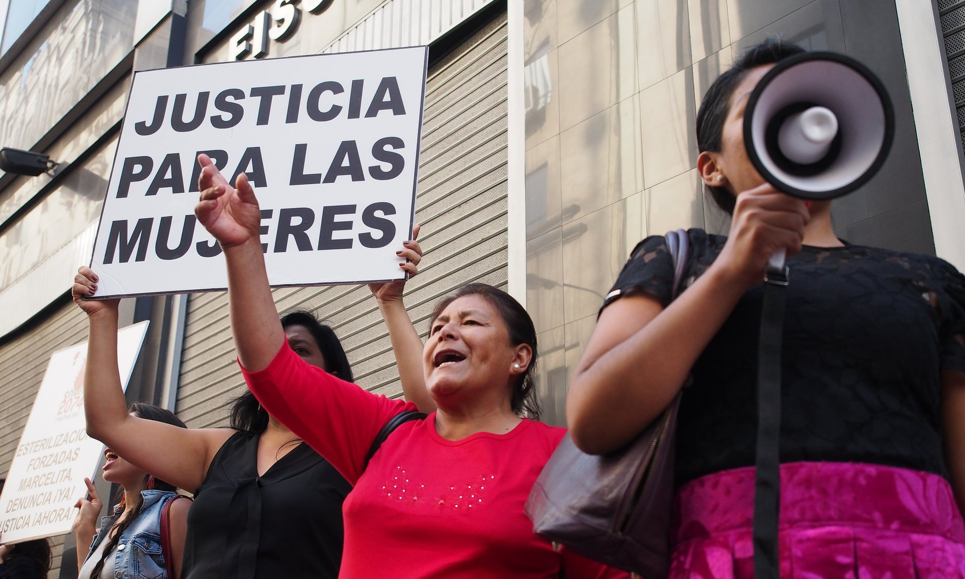 Women protest outside the prosecutor's office in Lima demanding justice for rural women who were forcibly sterilised, 10 May 2016. Photograph: Pacif/Rex/Shutterstock