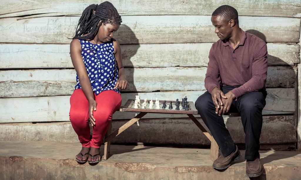 All the right moves: Phiona Mutesi with her chess mentor Robert Katende . Photograph: Muyingo Siraj
