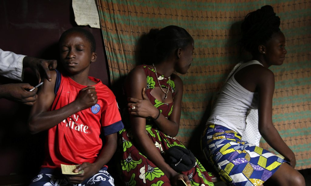 Residents of the Kisenso district of Kinshasa, receiving yellow fever vaccine injections last month. Photograph: Jerome Delay/AP