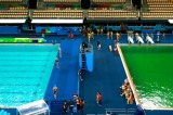 Olympic Divers Splash Into Green Pool