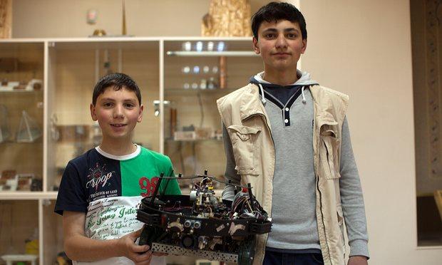 Rafael and Sahak Sahakyan with their firefighter robot. Photograph: Suren Stepanyan