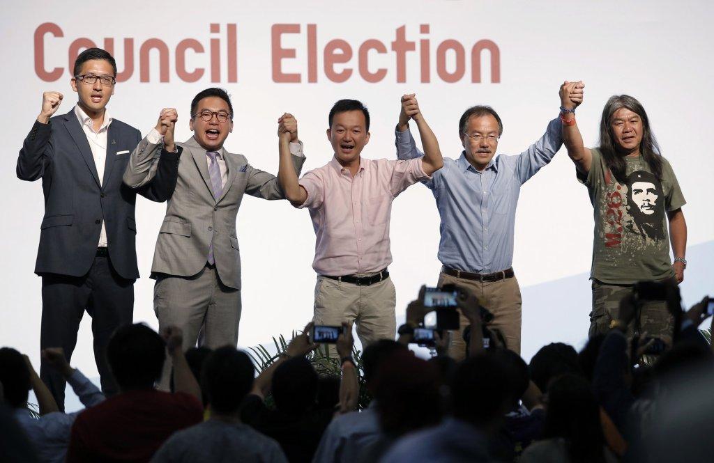 Pro-democracy candidates Lam Cheuk-ting, Alvin Yeung Ngok-kiu, Raymond Chan Chi-chuen, Fernando Cheung and Leung Kwok-hung (left to right) celebrate after winning seats. Photograph: Kin Cheung/AP