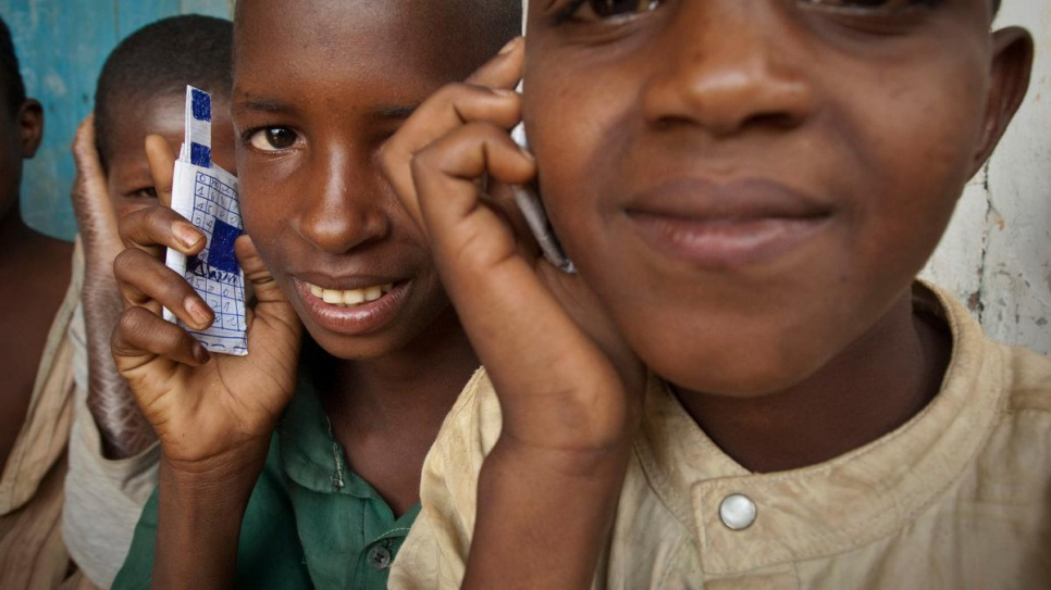 Children at a school in Gbiti, Cameroon, play with cellular phones that they drew, in this 2009 file photo. © UNHCR/ Frederic Noy