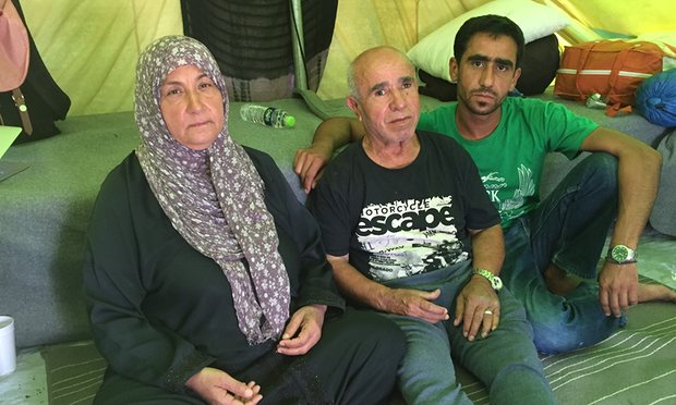 Hendiya Asseni with her husband Badreddine and their son Mohammad. After Badreddine suffered a stroke in the Softex refugee camp, doctors said he should be placed in permanent accommodation. Photograph: Patrick Kingsley for the Guardian