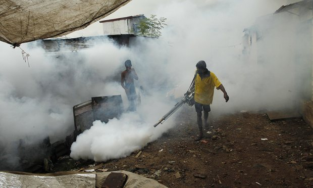 A Sri Lankan worker fumigates buildings to control mosquitoes in Colombo. Photograph: Eranga Jayawardena/AP