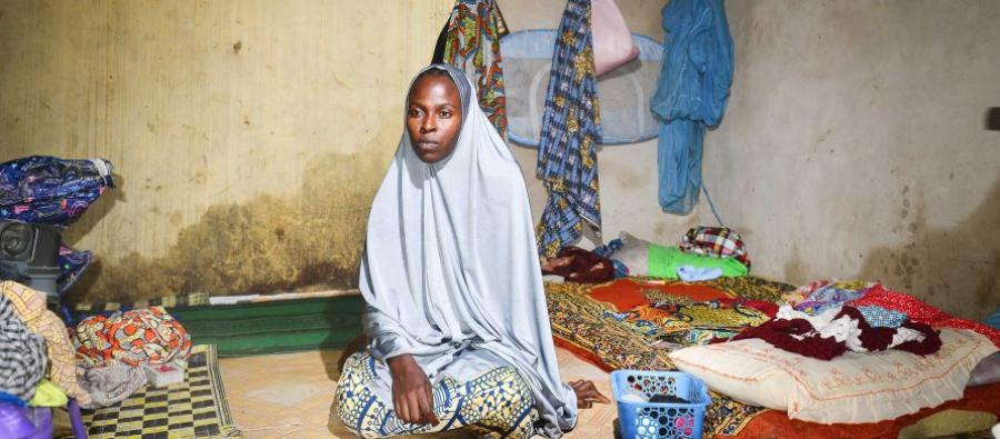 Aisha, 25 years old, fled with her 3 children after Boko Haram burned down her village and killed her husband. She's now living among Kabbar Maila, a host community in Maiduguri, where she sought refuge after having spent 18 days in the forest. Photos: Ibrahim Dung/Oxfam