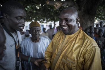 Gambian presidential candidate Adama Barrow greets supporters in Jambur on November 26. Barrow is backed by a coalition of seven opposition parties and has called on President Jammeh to accept the result of the election if he is defeated. MARCO LONGARI/AFP/GETTY