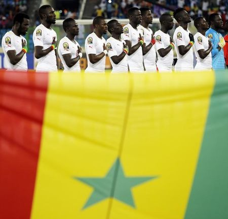 Senegal national soccer team players listen to their national anthem before the start of their Group C soccer match against Algeria in the African Cup of Nations in Malabo January 27, 2015. REUTERS/Amr Abdallah Dalsh