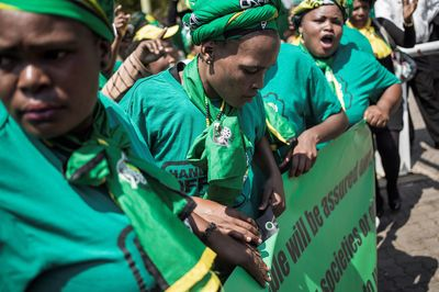African National Congress Women League (ANCWL) members demonstrate support of Bathabile Dlamini outside the Constitutional Court on March 15. Photographer: Ginaluigi Guercia/AFP/Getty Images