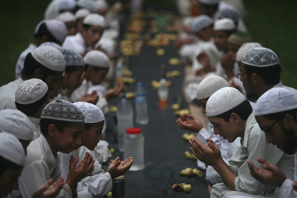 Muslims Praying in Madrassa