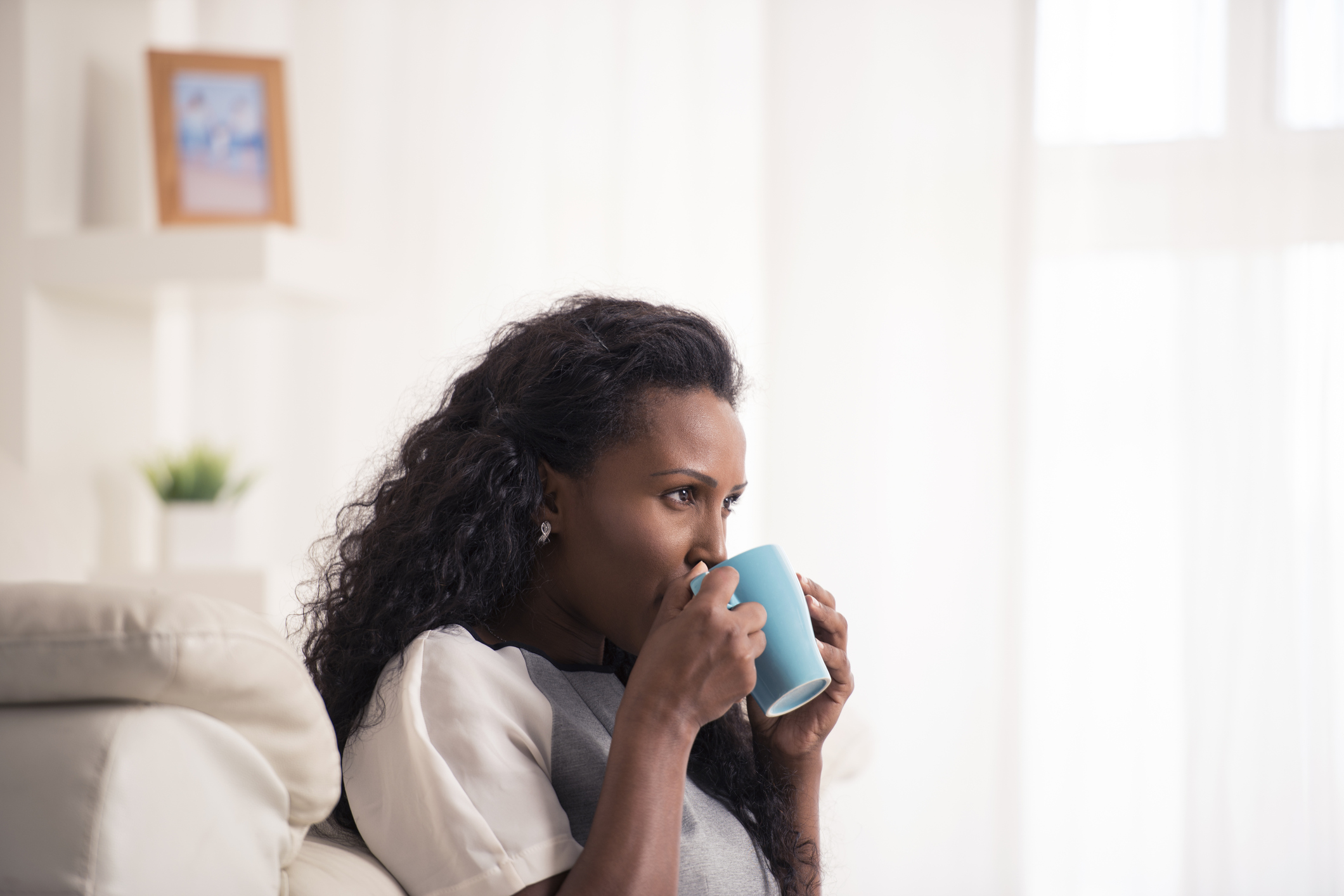 Woman with morning blue mug of coffee.