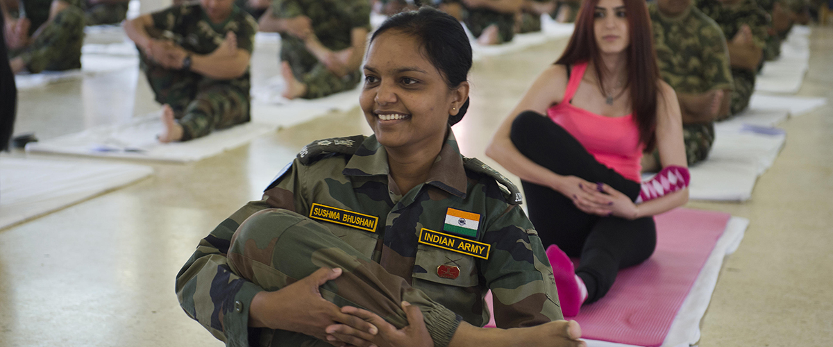 UNIFIL Indian Peacekeeper (front) and a Lebanese memeber of 'Sreedevi Daya Yoga Center' from Mount Lebanon (behind) practicing yoga during International Yoga Day in UNP 4-2 in the vicinity of Marjayoun in southern Lebanon. June 21st, 2015. Photo by Pasqual Gorriz (UN)
