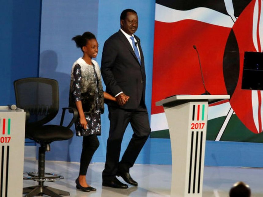 NASA flag bearer Raila Odinga arrives with his granddaughter for the presidential debate at Catholic University of Eastern Africa, July 24, 2017. /REUTERS