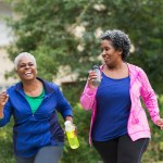 Two senior black women exercising together