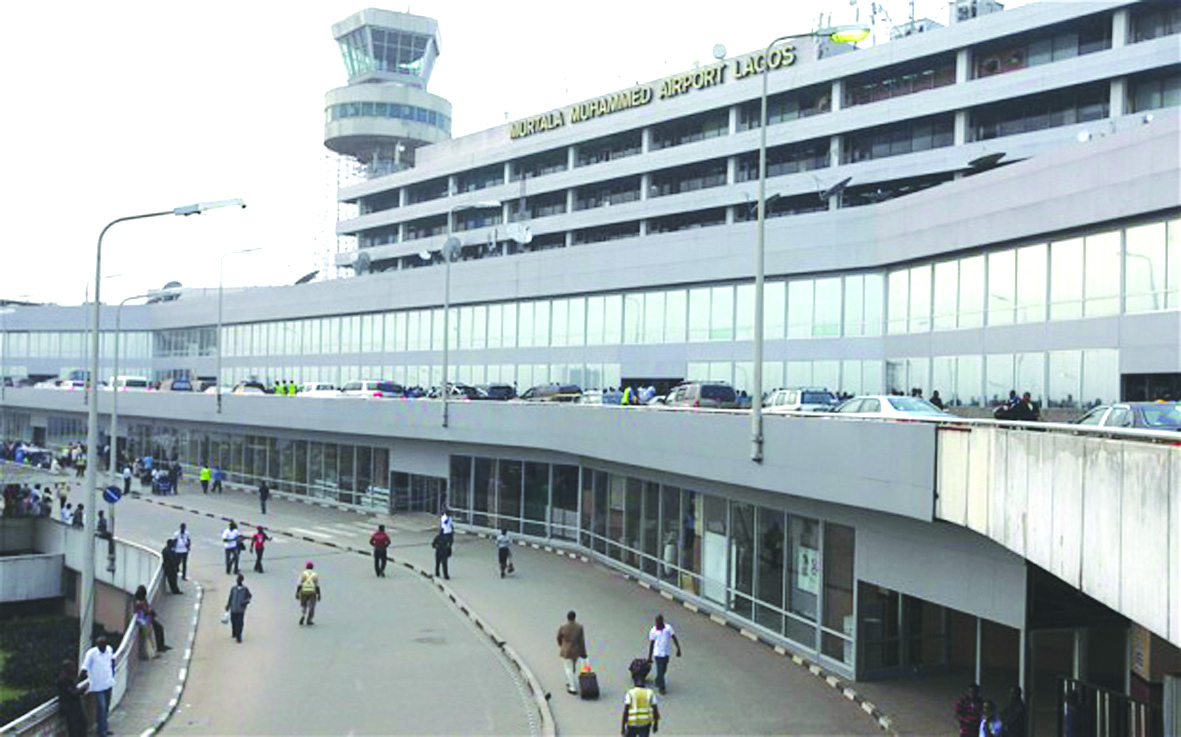 "In this photo taken on Monday, Feb. 4, 2013 passengers and passerby are seen at the Murtala Muhammed International Airport  in Lagos, Nigeria.  A British national has been kidnapped near Lagos international airport, in Nigeria's commercial capital, the British Consulate-General reported Friday, July 19, 2013. Spokesman Wale Adebayo says diplomats are working with Nigerian authorities on this week's kidnapping. He said he could give no other information because of the ""sensitive nature"" of the issue. (AP Photo/Sunday Alamba)"