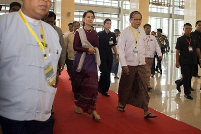 Aung San Suu Kyi arrives to deliver a national address in Naypyidaw on Sept. 19. Photographer: Ye Aung Thu/AFP via Getty Images