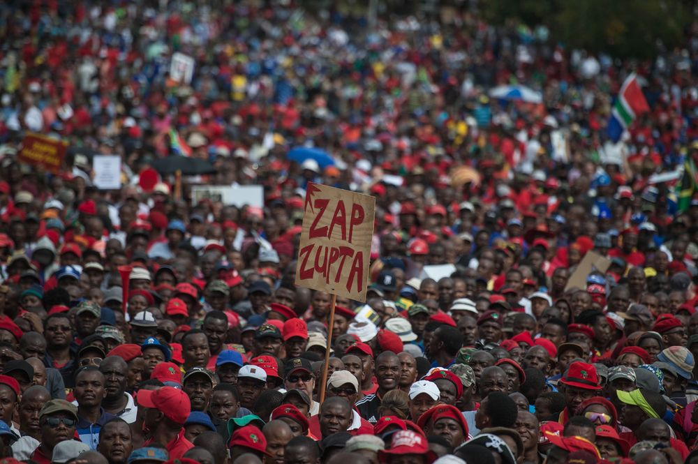 A protester holds a placard reading 'Zap Zupta', referring to Zuma and the Gupta Family, in Pretoria on April 12, 2017. Photographer: Mujahid Safodien/AFP/Getty Images