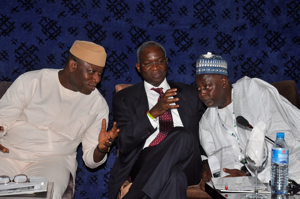 L-R: Minister of Mines and Steel Development, Dr Kayode Fayemi and Minister of Power, Works and Housing, Mr Babatunde Fashola (SAN); and President, Miners Association of Nigeria (MAN), Alhaji Shehu Sani; at the opening session of the Nigeria Mining Week, in Abuja