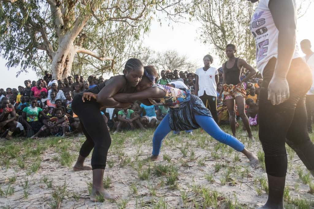 Girls and young women wait their turns to wrestle at the Festival of the King of Oussouye, where they can compete in traditional wrestling alongside the men. Ricci Shryock for BuzzFeed News