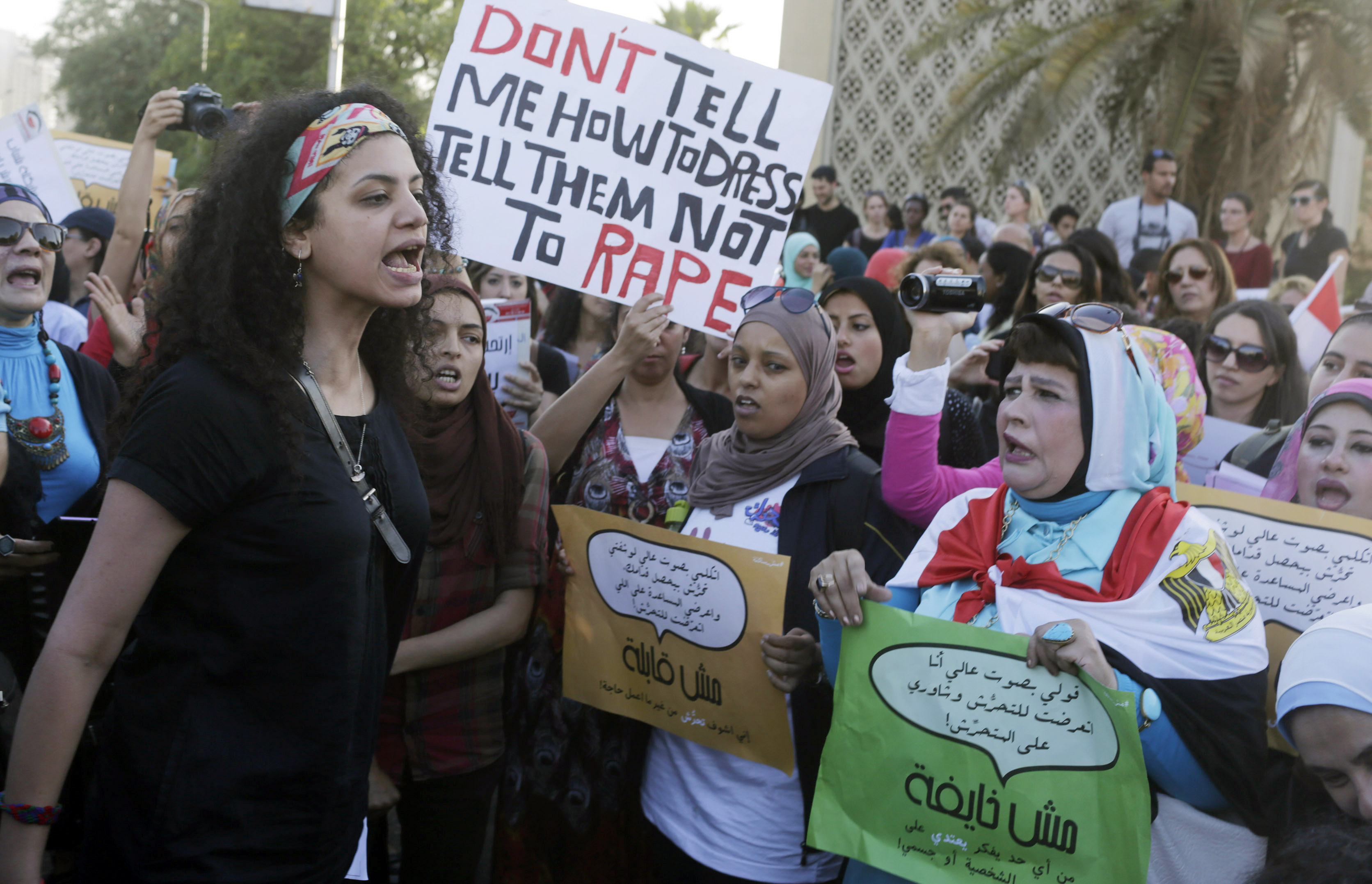 Women chant slogans as they gather to protest against sexual harassment in front of the opera house in Cairo June 14, 2014, after a woman was sexually assaulted by a mob during the June 8 celebrations marking the new president Abdel Fattah al-Sisi's inauguration in Tahrir square. Egypt has asked YouTube to remove a video showing the naked woman with injuries being dragged through the square after being sexually assaulted during the celebrations. Authorities have arrested seven men aged between 15 and 49 for sexually harassing women on the square after the posting of the video, which caused an uproar in local and international media. REUTERS/Asmaa Waguih (EGYPT - Tags: POLITICS CIVIL UNREST CRIME LAW) - RTR3TS3T