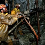 Mineworkers work deep underground at Harmony Gold Mine's Cooke shaft near Johannesburg, September 22, 2005.