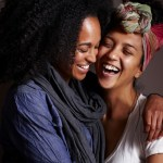 Smiling women hugging