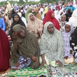 Nigeria Muslims offer Eid al-Adha prayers in Lagos, Nigeria, Saturday, Oct. 4, 2014. Muslims around the world will celebrate Eid al-Adha, the Festival of Sacrifice, to mark the end of the hajj pilgrimage by slaughtering sheep, goats, cows and camels to commemorate Prophet Abraham's readiness to sacrifice his son Ismail on God's command. (AP Photo/Sunday Alamba)