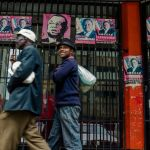 Posters portraying Morgan Tsvangirai in Harare on Nov. 15, 2017 Source: AFP/Getty Images