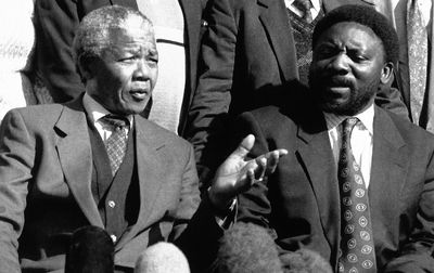 Nelson Mandela talks with Cyril Ramaphosa in June 1992 Photographer: Denis Farrell