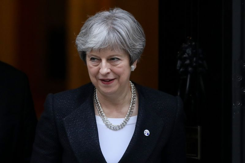 "Theresa May, U.K. prime minister, leaves number 10 Downing Street following a meeting with Estonia's Prime Minister Juri Ratas in London, U.K., on Tuesday, Jan. 30, 2018. Brexit campaigners in the U.K.'s governing Conservative Party would be ""foolish"" to try to overthrow May, Cabinet minister Liam Fox warned, as the prime minister battles critics on multiple fronts. Photographer: Luke MacGregor/Bloomberg"