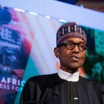 Nigerian President Muhammadu Buhari canceled his trip saying his government needs more time for input from local businesses. Photographer: Michael Nagle/Bloomberg