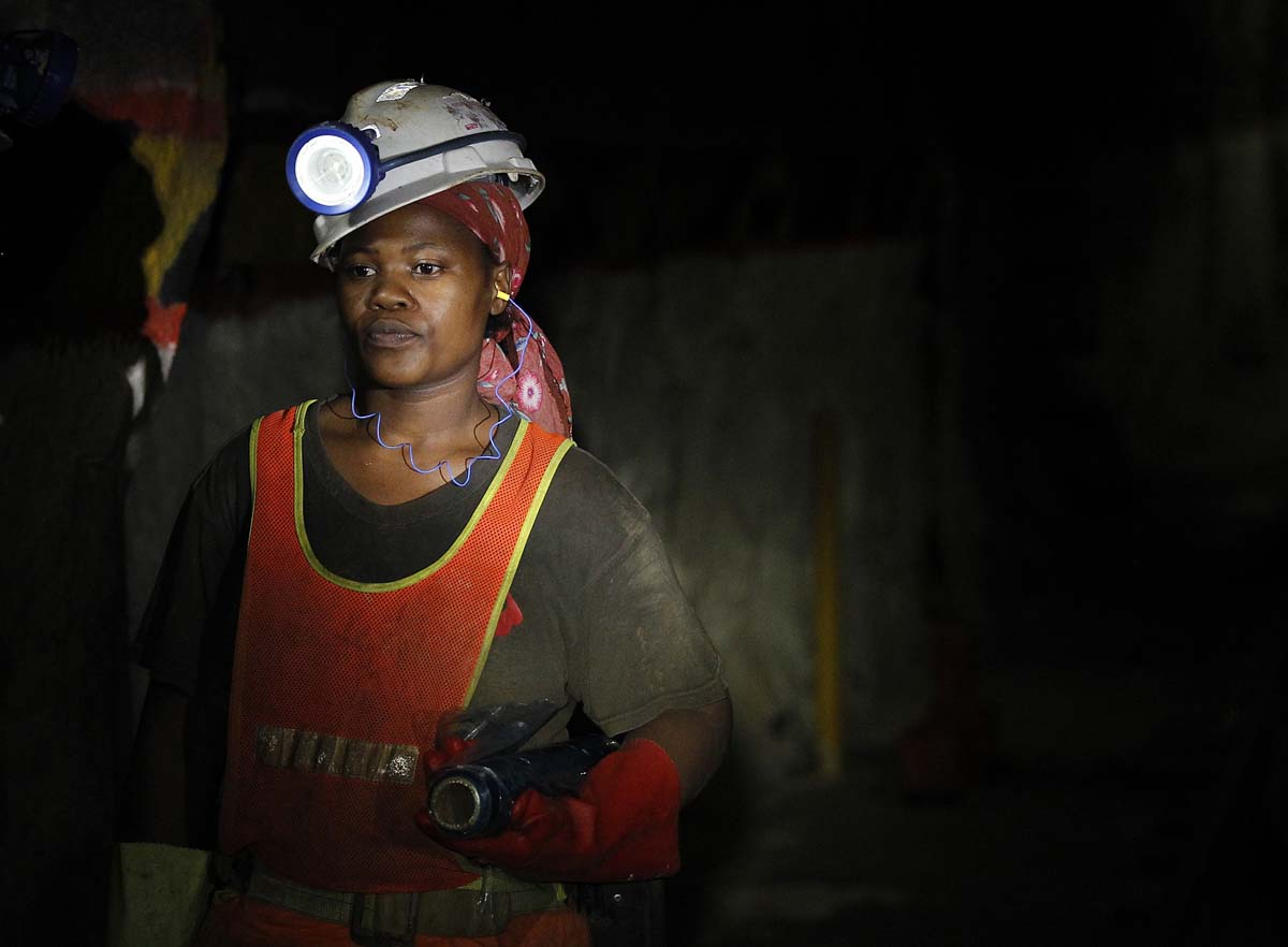 A female mine worker is seen underground  at Lonmin's Karee mine in Rustenburg, 100 km (62 miles) northwest of Johannesburg, March 5, 2013. Thousands of miners remained on strike at two shafts in South Africa's Marikana platinum mine on Tuesday, operator Lonmin Plc said, revising an earlier statement that they had gone back to work. REUTERS/Siphiwe Sibeko (SOUTH AFRICA - Tags: CIVIL UNREST BUSINESS EMPLOYMENT COMMODITIES) ORG XMIT: SSIB07