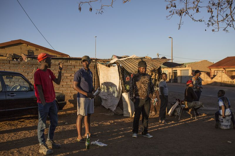 Local residents in Khutsong, Carletonville. Photographer: Guillem Sartorio/Bloomberg