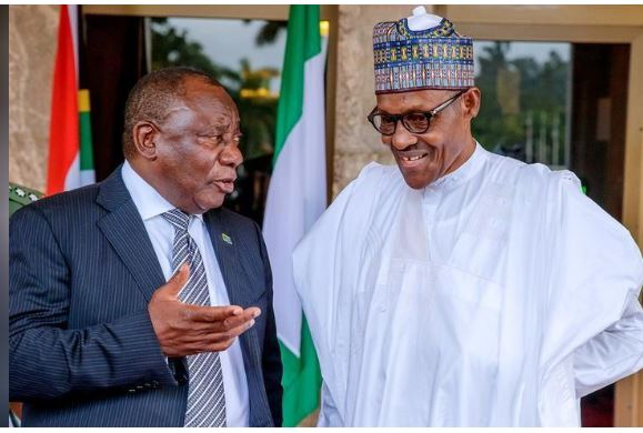 South Africa's President Cyril Ramaphosa speaks to Nigeria's President Muhammadu Buhari at the State House in Abuja, Nigeria July 11, 2018. Nigeria Presidency/Handout via Reuters