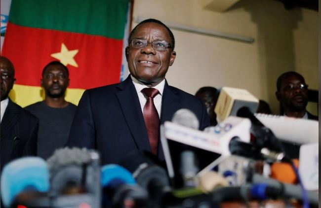 Maurice Kamto of Renaissance Movement (MRC) smiles as he holds a news conference at his headquarter in Yaounde, Cameroon October 8, 2018. REUTERS/Zohra Bensemra