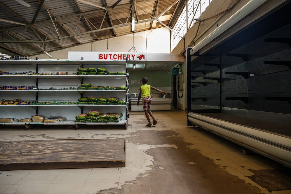 Empty shelves in a grocery store in Harare. Photographer: Jekesai Njikizana/AFP via Getty Images