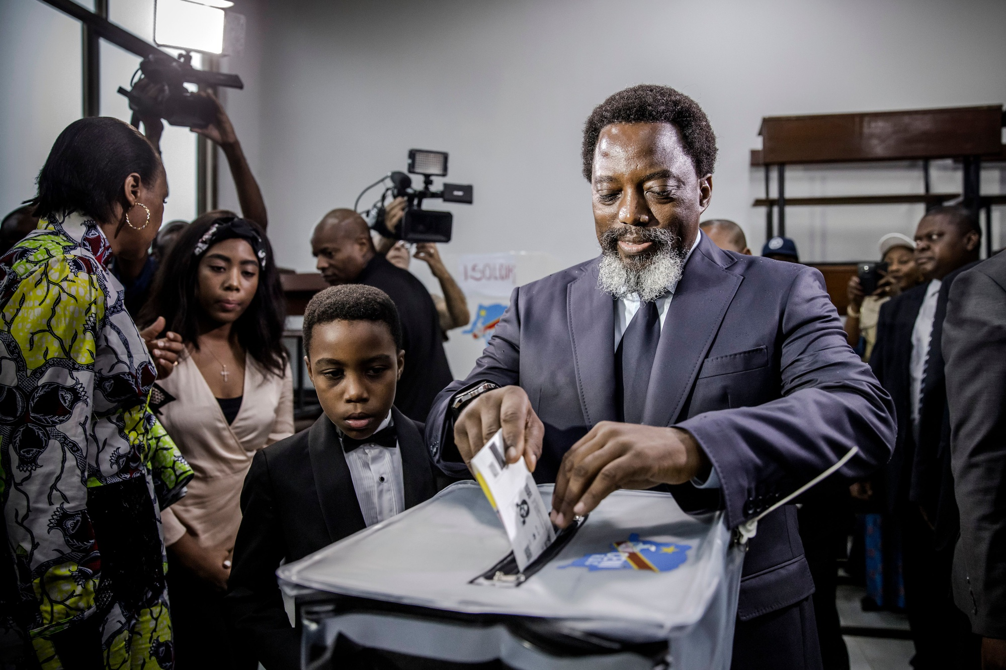 Joseph Kabila casts his vote on Dec. 30 Photographer: Luis Tato/AFP via Getty Images